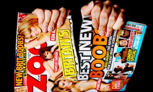 Copy of Zoo men's magazine being ripped in half