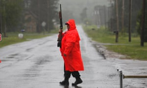 A corrections officer works at a roadblock in Owls Head, New York, on Tuesday as the search continues for two prison escapees. Bad weather has hampered the search.