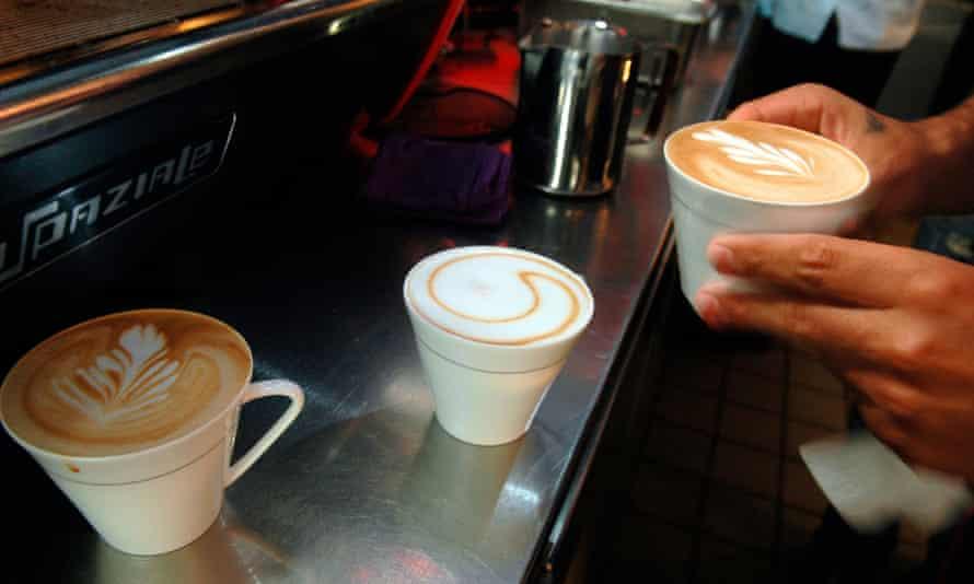 Barista prepares coffee drinks