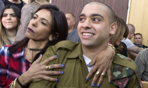 Elor Azaria is embraced by his mother at the start of his sentencing hearing in a Tel Aviv military court on Tuesday.