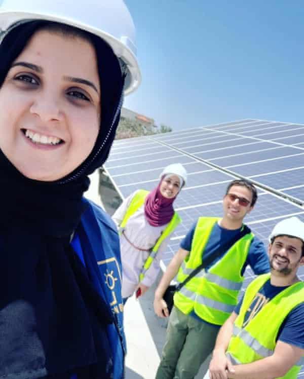 Majd Mashharawi installs the SunBox system with (from left); Ahmad Barzaq, Ammar Nada and Riham Abu Haiba