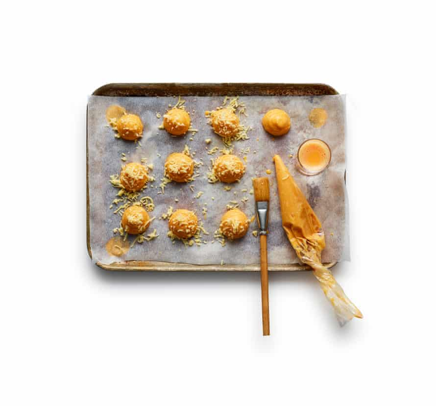 Spoon or pipe balls of the pastry mix on to lined oven trays, brush with egg and bake for 20 minutes.