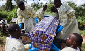 Health workers take part in the funeral of an Ebola victim in the Democratic Republic of the Congo