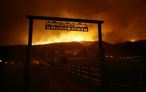 Fire burns on the ridge above a ranch on Twisp River Road