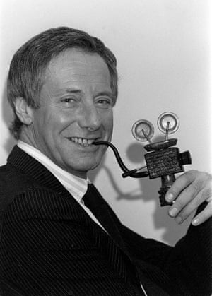 Norman puffs on the film-oriented pipe presented to him when he was installed as Pipeman of the Year for 1987 at the Pipesmokers' council's charity lunch at the Savoy hotel