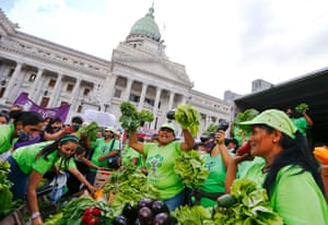 ArgentinaTraders give away vegetables as in an International Women's Day rally. The main demand was an end to a wave of femicides and transvesticides.