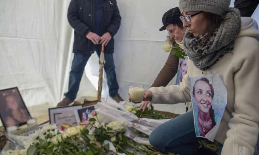 Relatives and friends of Julie Douib light candles in her memory after a march in her home town of Vaires-sur-Marne, near Paris