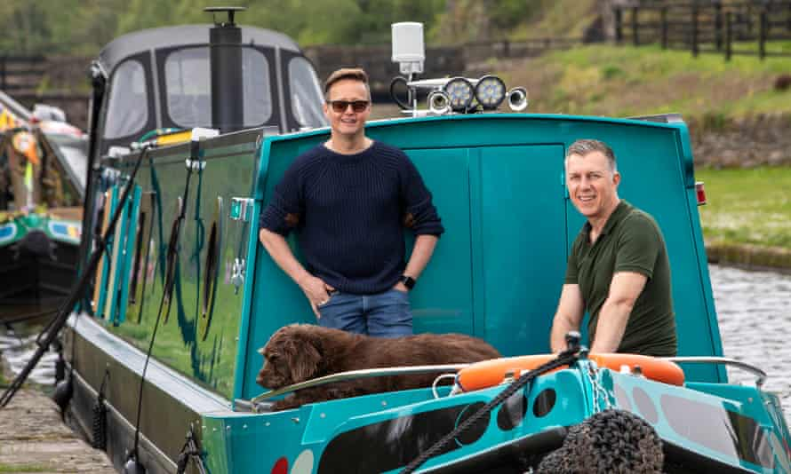 Anthony, left, and Paul Smith-Store, with Dexter the dog, in their motorboat at Bugsworth Basin, Derbyshire.