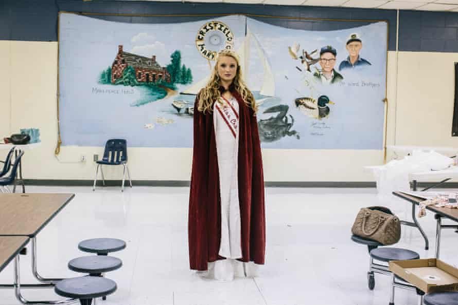 Casey Milbourne stands in the cafeteria of Crisfield High School after being crowned the winner of the annual Miss Crustacean 2013 beauty contest.