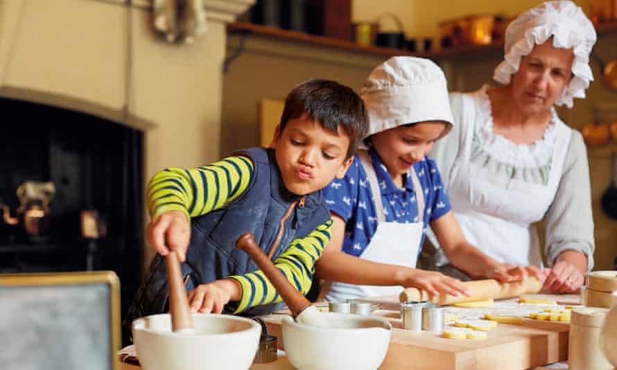 Children with a costumed interpreter, taking part in baking activities