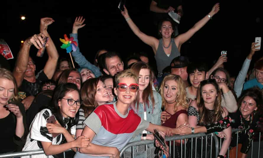 'Gloriously anarchic': Katy Perry poses with fans as she leaves her intimate gig at the the Water Rats in King's Cross last month.