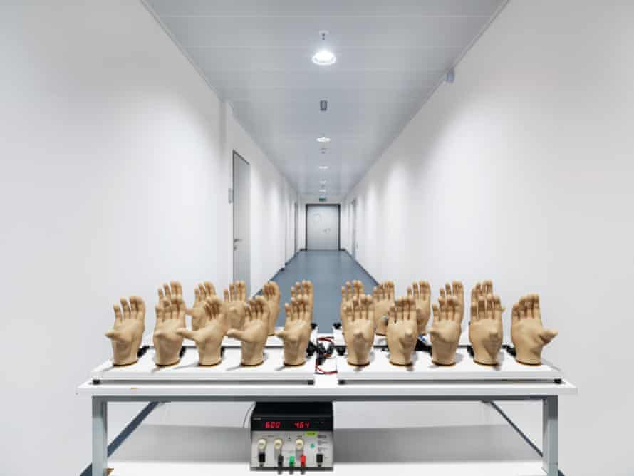 Reiner Riedler's unsettling 2013 picture of prosthetic hands on a test station.