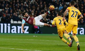 West Ham Andy Carroll acrobatically makes it 2-0.