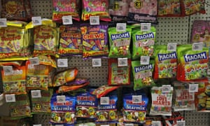 Sweets are on display at a shelf in a supermarket in London, Thursday, Aug. 18, 2016