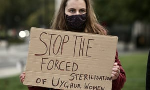 A woman at a London protest in support of the Uighur people over ongoing human rights violations in China's Xinjiang autonomous region, on 8 October 2020.