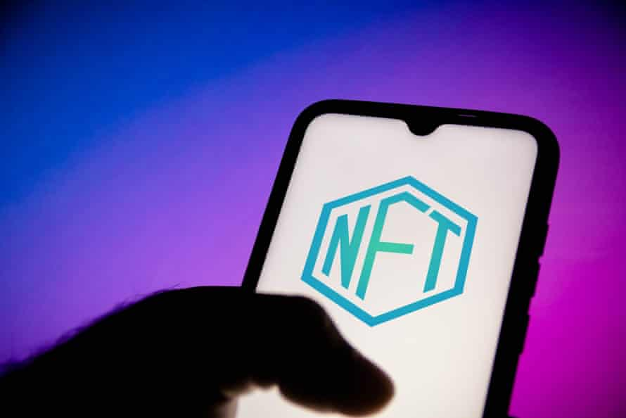 A non-fungible token logo is displayed on a smartphone