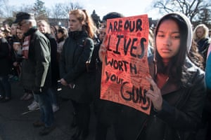 "This Georgetown University student in Washington, DC held up a sign that was as detailed, close-up, as it was bold in message: ""Are our lives worth your guns?"""