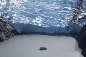 A tour boat at the end of a glacier in the Kenai mountains, Alaska, US