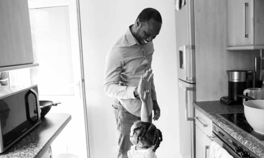 Aaron Sylvester Black father with daughter in kitchen