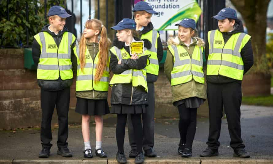 The junior PCSO team at work outside the school