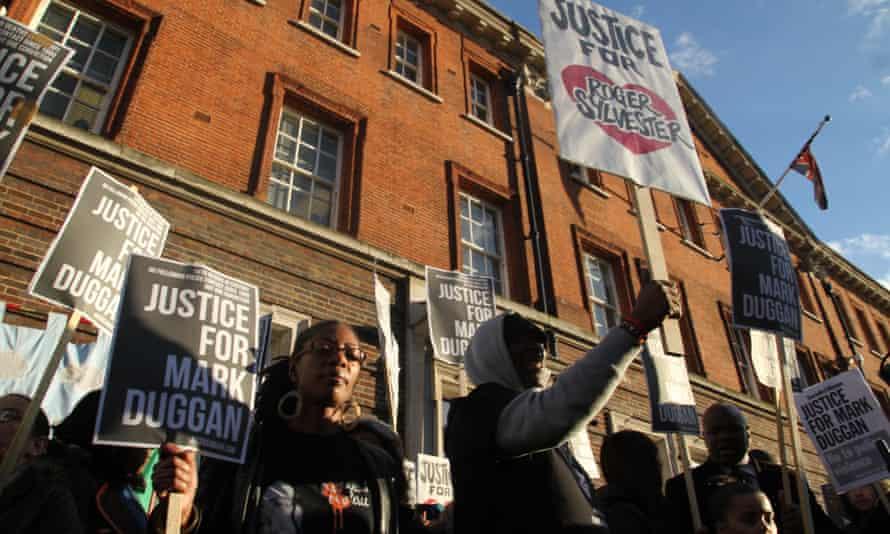 Demonstrators outside Tottenham police station