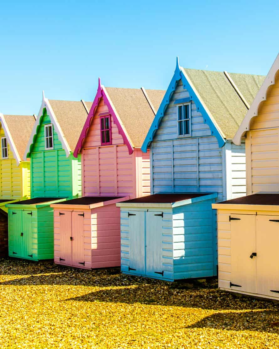 'Beach bunnies flock to this unspoilt nub of land': beach huts at West Mersea, Essex.