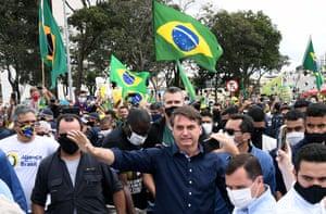 24 May: Bolsonaro greets supporters upon arrival at Planalto Palace in Brasília.