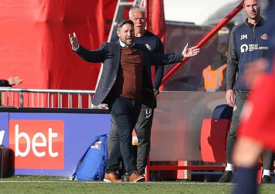 lee johnson shows his frustration during the first game.