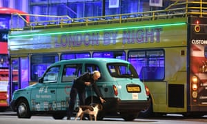 Police sniffer dogs on London Bridge.