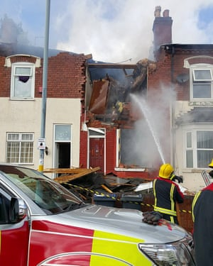 Firefighters tackle the blaze following a gas explosion at the property in Ladywood