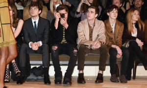Brooklyn Beckham, with camera, at a Burberry show in London