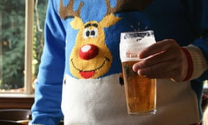 Man with pint in Christmas jumper