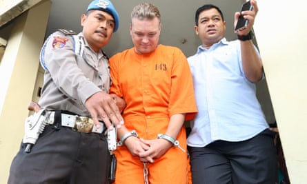 Two Australian men, William Cabantog and David Van Iersel, have been arrested in Bali amid reported links to a cocaine trafficking operation. Van Iersel is paraded by police before the media