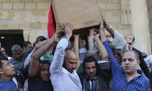 People carry the coffin of police captain Ahmed Fayez, who was killed in the gun battle in Giza province.