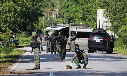 Members of a bomb squad inspect the site of an attack by suspected Muslim militants in Yala province that killed at least 15 people.