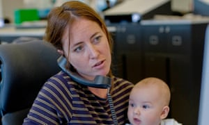 Woman with baby in office