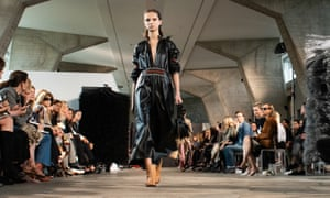 A model wears a long leather kaftan dress at the Loewe show