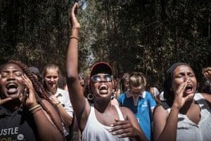 Students of Braeburn Garden Estate School chant during a march at Karura forest in Nairobi.