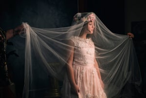 """The uncle is the fashion designer, present in the Oreste Pipolo studio for the pre-communion shooting. They try the dress and make the latest adjustments. """"it is even more beautiful than I expected,"""" says Francesca """"it's important because for a special day we need a special dress""""."""