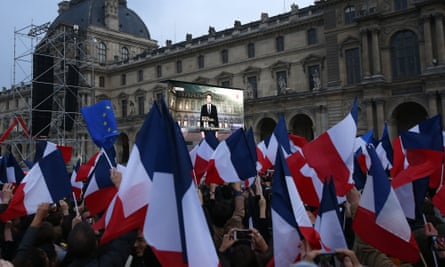 Emmanuel Macron's victory speech broadcast on screens at the Louvre
