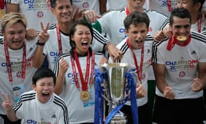Chan Yuen-ting, second from left, celebrates with her players after winning the Hong Kong Premier League title