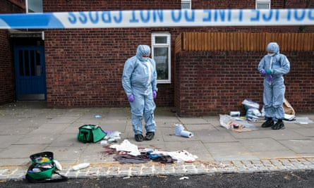 A forensics team work at the scene of a stabbing in Edmonton