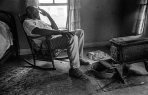 """Grimes County, Texas, 1972. Willie Buckhannon in his bedroom. """"My partner Wendy Watriss and I chose to record the different cultural frontiers in Texas. The Buckhannon family was part of the African American heritage of the Southern Frontier. © Fred Baldwin and Wendy Watriss."""