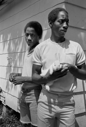 Sage Sohier, Young men with rabbit, Baton Rouge, Louisiana, 1983