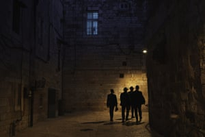 Ultra-Orthodox Jewish men walk at night in Jerusalem's Old City days after a cease-fire was reached in the 11-day war between Gaza's Hamas rulers and Israel.