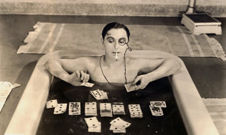 Lupino Lane Playing Soggy Solitaire in <br>1926 --- As one of the idle rich, Lupino Lane's character plays solitaire in the bathtub. --- Image by Bettmann/CORBIS Fool's Luck Motion Picture, 1926
