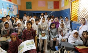 Students attend a class at Mashal Model School on the outskirts of Islamabad, Pakistan