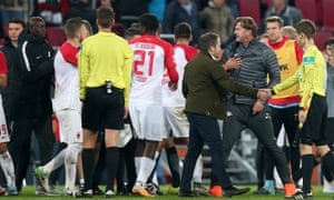 RB Leipzig coach Ralph Hasenhüttl confronts Augsburg's Daniel Baier at the final whistle.