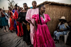 Wearing creations by Adama Paris, the Senegalese designer who organises the fashion week, models queue for their exit.