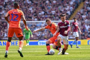 Jack Grealish is fouled by Millwall's Ben Thompson.